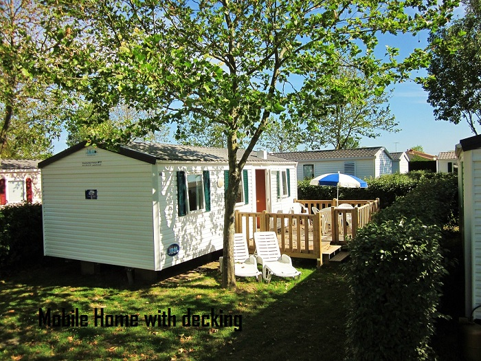 Thomas James Vendee Holidays Mobile Home with wooden decking.JPG