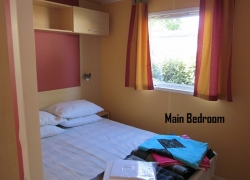 Thomas James Vendee Holidays Mobile Home Main Bed.JPG